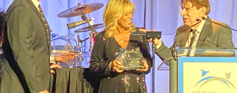 Image of Principal Mitchell receiving award on stage