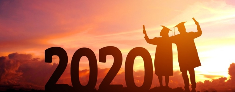 image of 2020 silhouette in sunset with 2 graduates